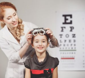 a young girl at an eye exam